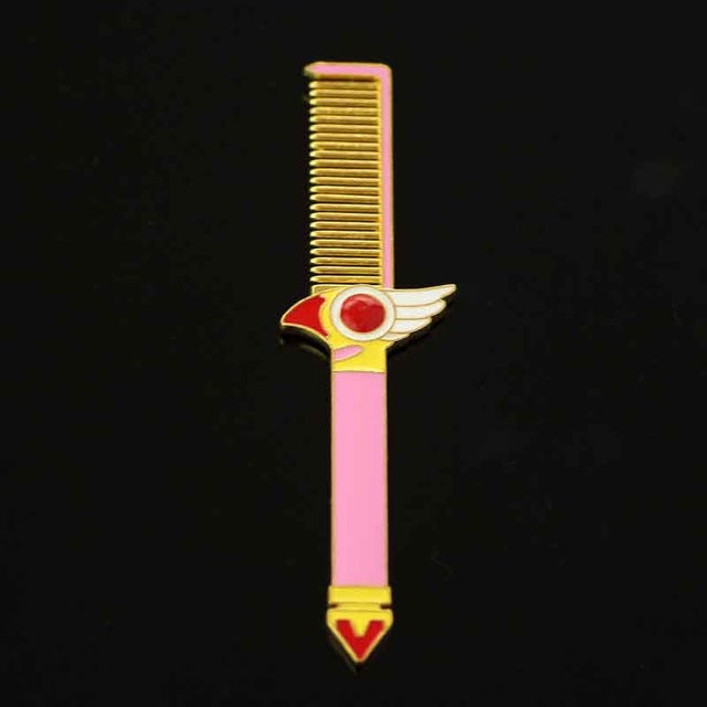 Cardcaptor Sakura Kinomoto anime themed pink hair comb, a cute gift for any CCS fan! Design inspired by the magical clow sealing staff wand. Kawaii beauty tool.