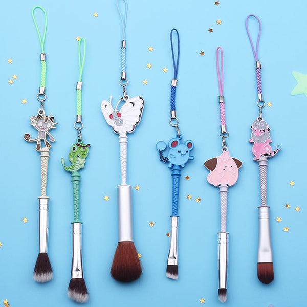 This adorable Pokemon makeup brush set features designs of Meowth, Caterpie, Butterfree, Marill, Clefairy, & Flaaffy, a perfect gift for any Pokemon fan!