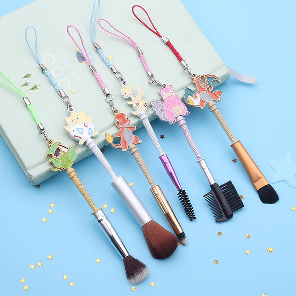 This adorable Pokemon makeup brush set features designs of Charmander, Charizard, Togepi, Togetic, Victreebel, & Slowbro, perfect for any Pokemon fan!