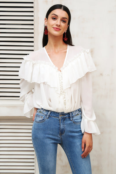 The Juliette Ruffled Blouse is a vintage, chiffon-style white button top with a 'V' neckline, long sleeves with ruffled hem at the cuffs, &  large ruffle tier across the chest & back (sailor cape style!) One size fits all US 0-12, EU 32-42.