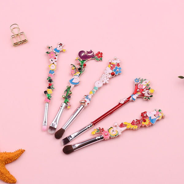 Alice in Wonderland Floral Brush Set- This gorgeous 5-piece makeup brush set features familiar designs from the classic Alice in Wonderland tale, including Alice, the Cheshire cat, and the rabbit with a lovely floral flair!