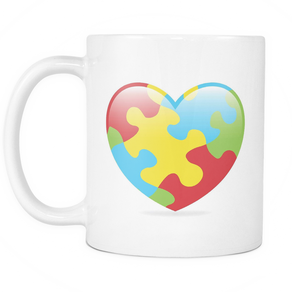 Autism heart white 11 oz coffee mug. Colors red, blue, yellow, green.