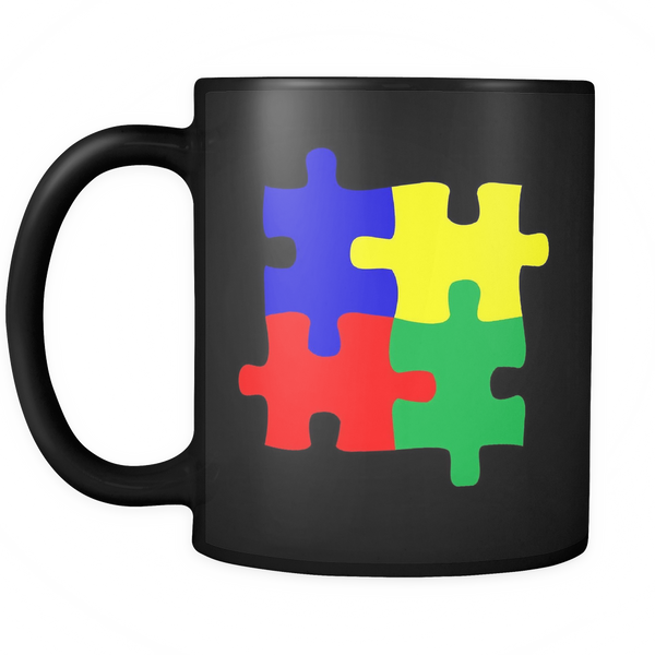 Autism puzzle coffee mug. Puzzle pieces in blue, yellow, red, and green. Black mug 11 ozs.