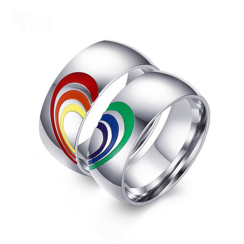 Show your love with a set of 2 rainbow heart rings. Keep one to wear and give the other to a friend, loved one, or a companion.