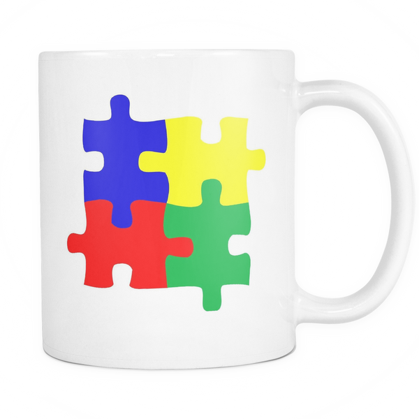 Puzzle pieces Autism white coffee mug, 11 ounces. Each piece has a different color - red, blue, yellow, and green