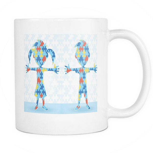 Autism mug featuring 2 kids made out of puzzle pieces. White 11 oz coffee mug.