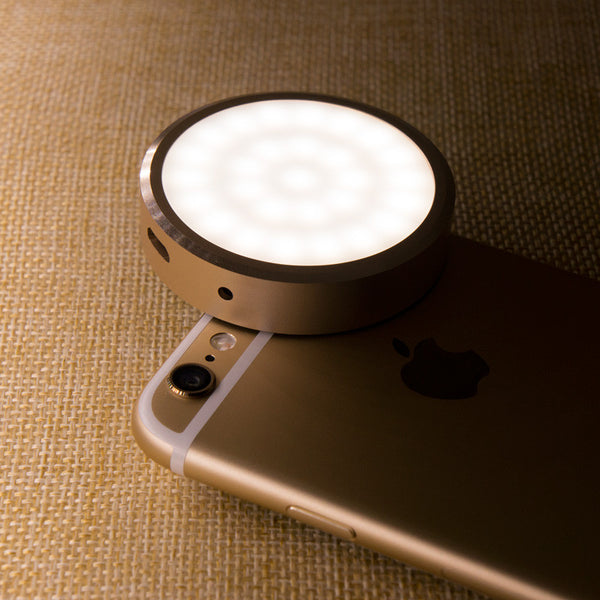 Gold ipone selfie light. Light and small so it can be easily carried in pocket or bag and placed on your phone wherever you want.