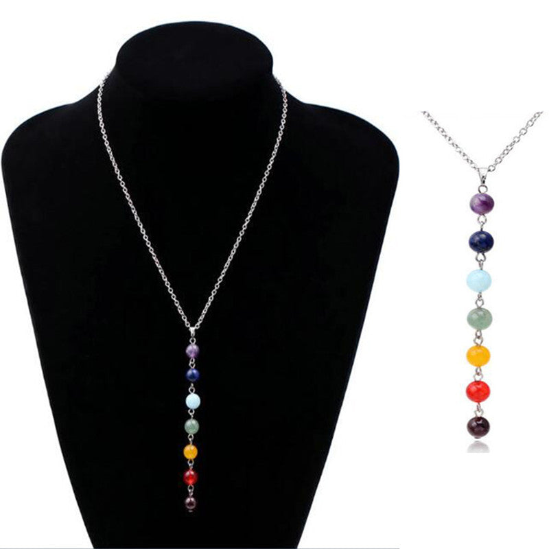 7 Chakra Pendant Necklace is made of man made stone - Lapis, Turquoise, Amethyst, jade, Agate stone, Silver Plated chain and is approx 3 1/2