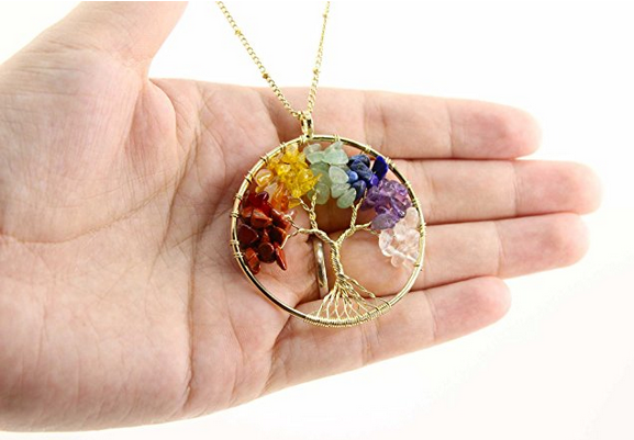 7 chakra stones arranged on gold plated copper wire branches in a beautiful tree look.