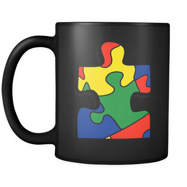 Autism support coffee mug featuring a single puzzle piece with the colors red, green, blue, and yellow. 11 ounces