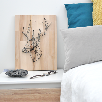 Add sophistication to your home with this geometric, minimalist yarn art - Deer