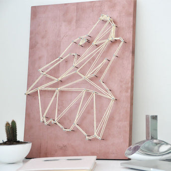 Add sophistication to your home with this geometric, minimalist yarn art - Wolf