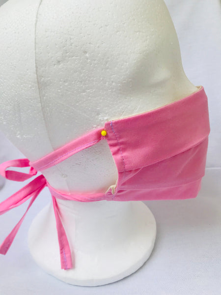 Pink pleated cotton face mask with tie back cords