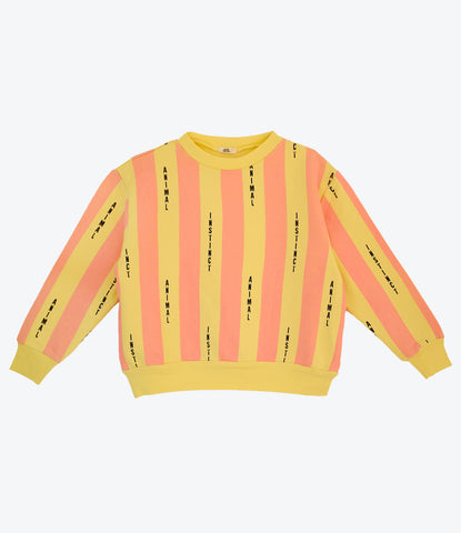 Bandy Button Animal Sweat, from Animal Instinct collection. Super cool girls sweat. Coral and Yellow tones. Available from Wilechile Boutique, Baby Boutique and kids store. Auckland. New Zealand