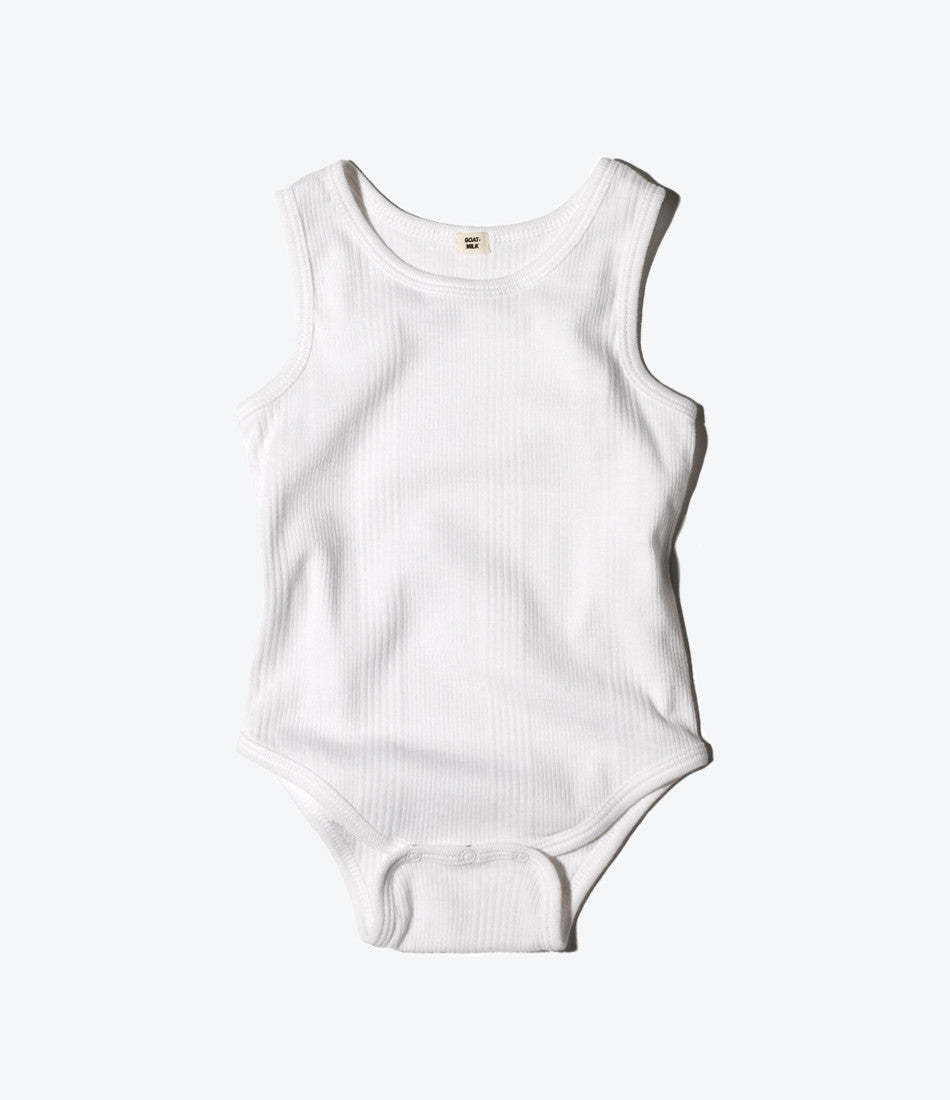 Goat milk nyc sleeveless onesie in white rib. unisex, organic, cotton, stretchy, comfy, clothing for babies and kids. available at wilechile boutique online store for baby and childrens clothing