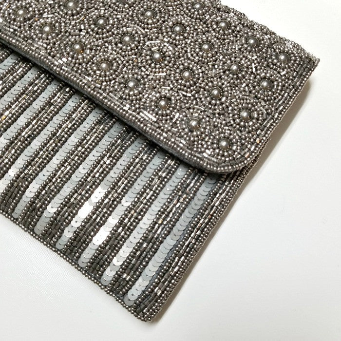 FROM ST. XAVIER SILVER BEADED CLUTCH