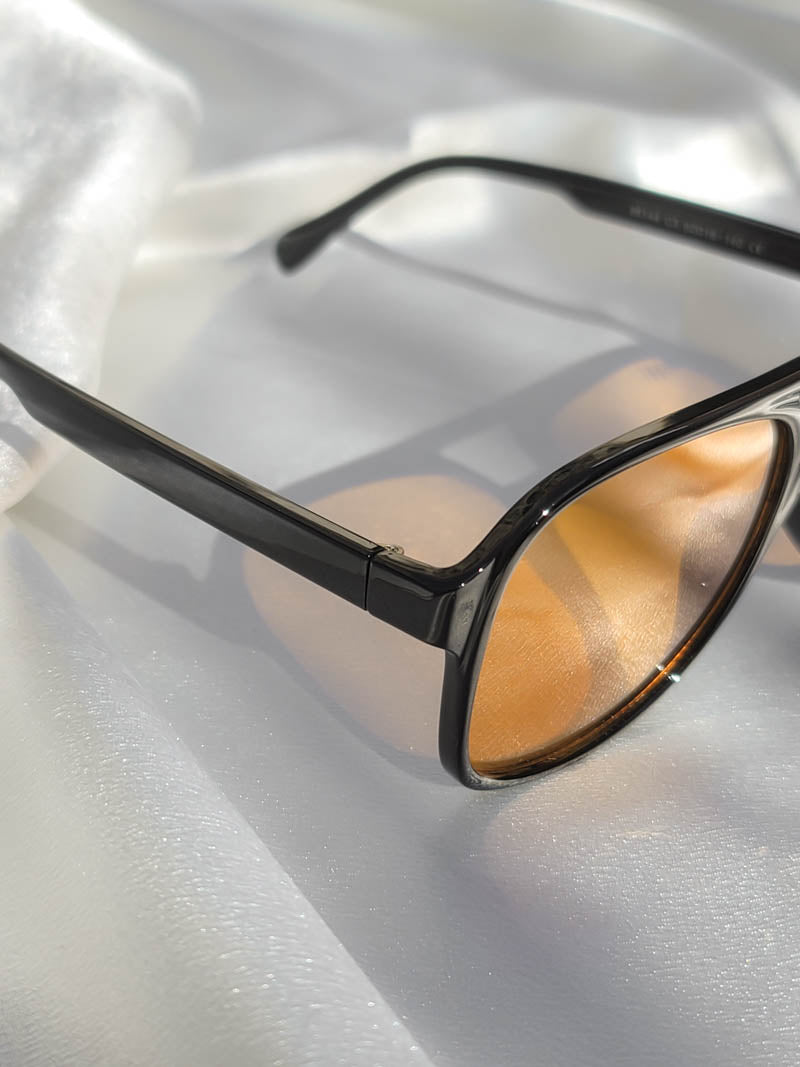 Black frame sunnies with amber lens