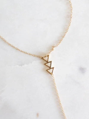 Dainty gold necklace with triangle details