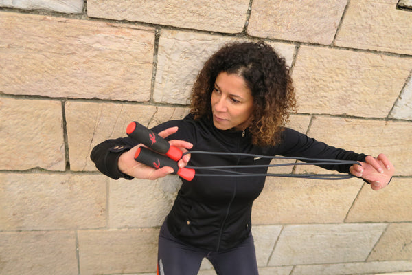 A woman holding the Fitness Factor Jump Rope