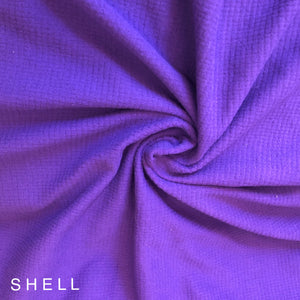 Royal Purple fabric has a waffle grid on it very soft wicks away moisture UV protection Polartec outdoor fabric compact minimal for backpacking