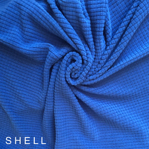 Blue fabric has a waffle grid on it very soft wicks away moisture UV protection Polartec outdoor fabric compact minimal for backpacking