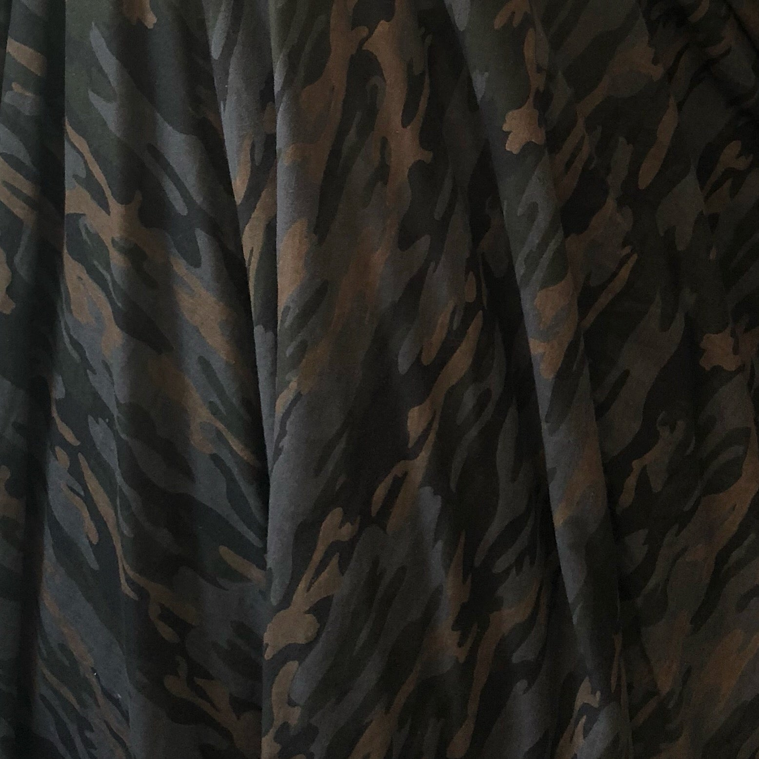 This is not your average camo fabric it is on the darker tone side with neutral earthy colors a sandy brown a night blue with black/gray this camo print is very unique guaranteed compliments!
