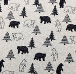 Load image into Gallery viewer, A variety of  silhouette and out lined bears and trees just over 1 in scattered throughout this cotton t-shit farbic with a light gray background. They look like very kind bears and happy trees