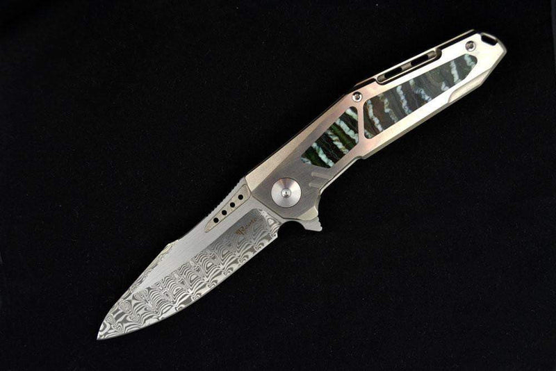 products/Mammoth_tooth_K-3_damasteel_1.jpg