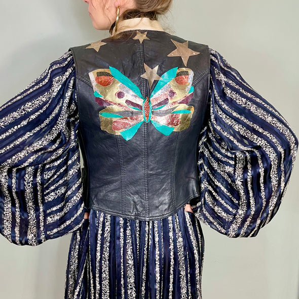 Clothilde, 70s leather black waistcoat with butterfly applique