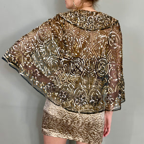 Suri, sparkly, gold and silver 20s cape