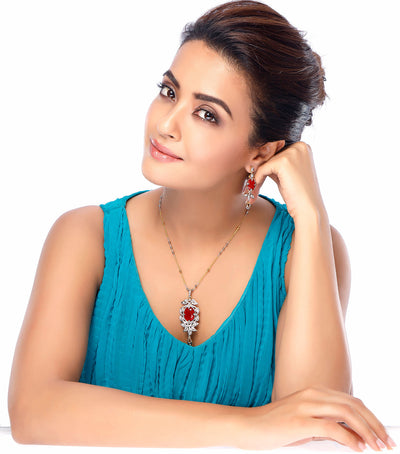 Sukkhi Surveen Chawla Collections Sleek Gold and Rhodium Plated CZ Pendant Set with Set of 5 Changeable Stone-1