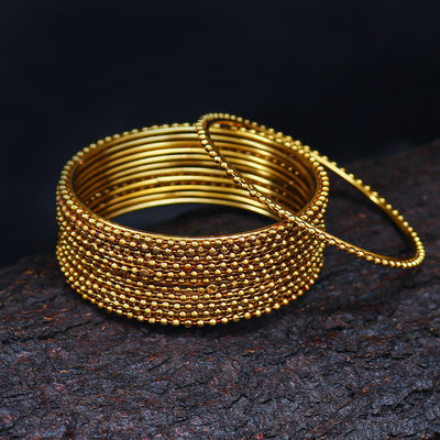 Sukkhi Glimmery Gold Plated Bangles For Women Set Of 12