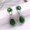 Sukkhi Designer Oval Green Crystal Stone Rhodium Plated Earring for Women