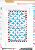 Five Patch Design Hand Illustrated Red and Blue Triangles Any Occasion Greeting Card Shown on Top of Other Cards