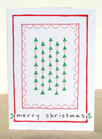 Five Patch Design Hand Illustrated Trees and Holly Merry Christmas Greeting Cards (Set of 6) Displayed Upright on Table