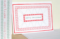 Five Patch Design Hand Illustrated Red Quilt Merry Christmas Greeting Card Displayed Upright on Table