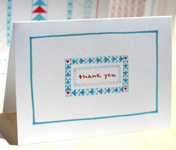Five Patch Design Hand Illustrated Red and Blue Simple Thank You Greeting Cards (Set of 6) Displayed Upright on Table