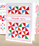 Five Patch Design Hand Illustrated Pinwheels Thank You Greeting Card Displayed Upright on Table