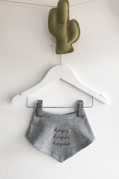 grey bandana bib with embroidered front