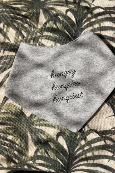 soft grey bib with hungry embroidery