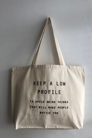 Keep a Low Profile Tote Bag