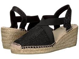 Black metallic espadrille wedge shoe by Toni Pons