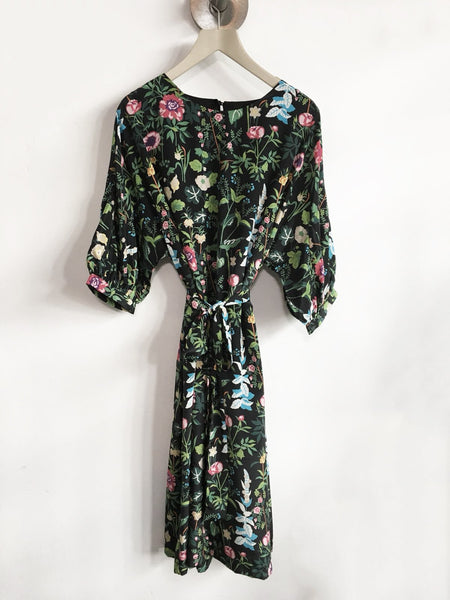 Floating floral dress with a satin look and silky feel