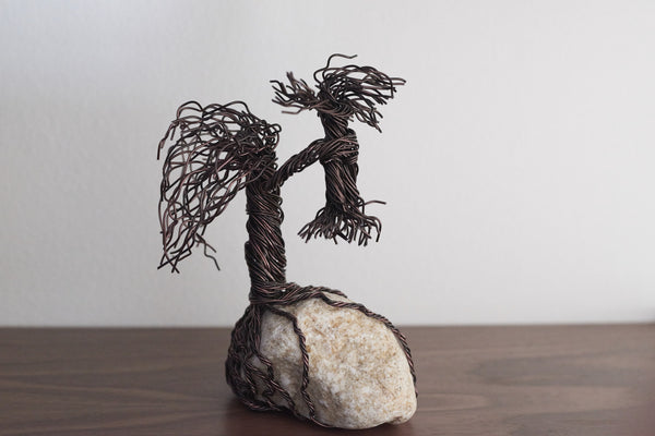 Adult & Child Ent Wire Sculpture on Rock