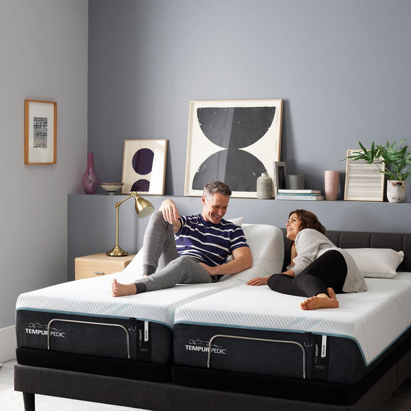 TEMPUR-ProAdapt® Medium Mattress Room Shot with Couple Relaxing