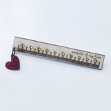 ruler and heart brooch