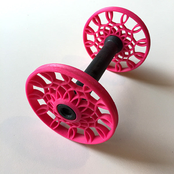 Flat-Pack Bobbin with Sunflower whorls in Magenta