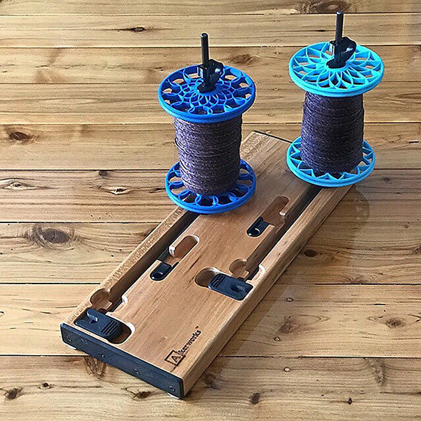 Flat-Pack Bobbins on Lazy Kate: Sunflower whorls in Royal Blue and Lotus whorls in Powder Blue