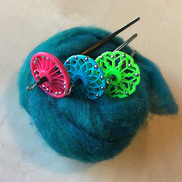 assorted Mini-Spindle Kits: Bike Tire in Magenta, Lotus in Powder Blue, and Honeycomb in Neon Green
