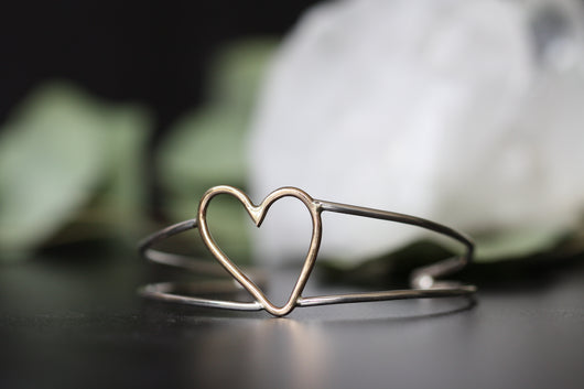 With an open Heart silver and gold cuff bracelet